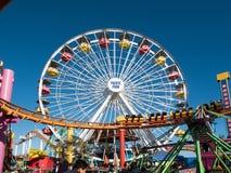 Santa Monica Pier Pacific Park Amusement Rides. Famous Santa Monica Pacific Park ferris wheel and amusement rides located on the Santa Monica pier over the Stock Photos