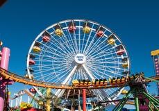 Santa Monica Pier Pacific Park Amusement Rides. Famous Santa Monica Pacific Park ferris wheel and amusement rides located on the Santa Monica pier over the Stock Images
