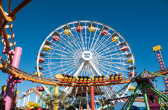 Santa Monica Pier Pacific Park Amusement Rides. Famous Santa Monica Pacific Park ferris wheel and amusement rides located on the Santa Monica pier over the Royalty Free Stock Photo