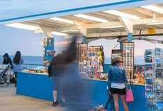 Santa Monica Pier people moving about at sunset Stock Image