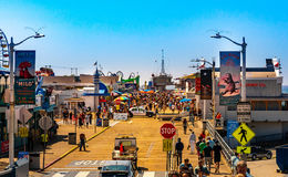 Santa Monica Pier, Picture with people walking at the pier with the end of Route 66. The amusement park is a famous attraction. Santa Monica, Los Angeles, CA stock images