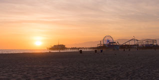 Santa Monica Pier sunset with cloud and orange sky, Los Angeles, Royalty Free Stock Images