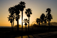 Santa Monica Pier at Sunset. A Santa Monica sunset on a warm day in Los Angeles, California, USA Royalty Free Stock Images