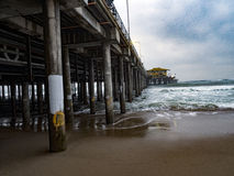 Santa Monica Pier - Waves and Pilings - Low Tide Royalty Free Stock Image