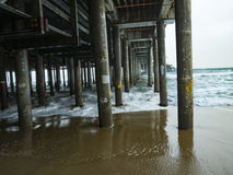 Santa Monica Pier - Waves and Pilings Royalty Free Stock Images