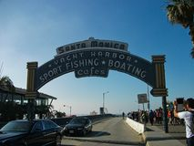 Santa monica sign in miami. Blue sky coast ocean summer tropical vacation beach design palm sea sun surf surfing california paradise print retro shirt surfer stock photos