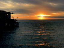 Santa Monica Sunset. The sun going down on a cloudy evening ate Santa Monica Pier, CA Stock Photo