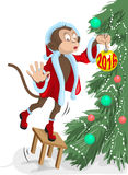 Santa monkey hangs on the Christmas tree ball in 2016. Illustration in vector format Stock Photos