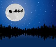 Santa in the moonlight Royalty Free Stock Photography