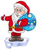 Santa with more gifts on iceberg Royalty Free Stock Images