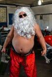 Santa on a motorcycle. Sunburned Santa biker riding motorcycle on summer vacations Stock Images