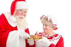 Santa and Mrs Claus with plate of cookies Royalty Free Stock Photo
