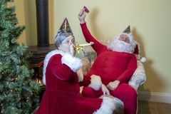 Santa and the Mrs. ringing in the New Year royalty free stock images