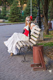 Santa Muerte. The girl in the image of Santa Muerte is sitting on a bench in the park Stock Photography