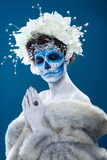 Santa Muerte woman at blue background Royalty Free Stock Images