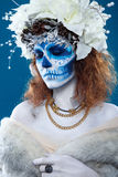 Santa Muerte woman at blue background Stock Photography