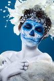 Santa Muerte woman at blue background Royalty Free Stock Photo