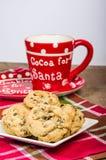 Santa mug with plate of cookies Stock Image