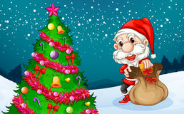 Santa near the big christmas tree Royalty Free Stock Photos