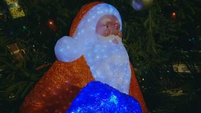 Christmas tree at the outdoor market. Santa near christmas tree at the outdoor market in old city stock video footage