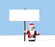 Santa at the North Pole holding a large blank sign Royalty Free Stock Photo