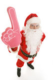 Santa Number One. Santa Clause with a big rubber hand showing the number one.  Full body on white background Stock Image