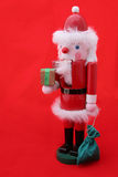 Santa Nutcracker on Red. A santa claus nutcracker against a bright red background. Room for text stock photography