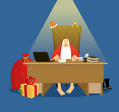 Santa office. Working residence in Lapland. Christmas big boss i. N Work. Jobs and armchair chief. Elf helper in green suit. Large red sack of gifts for children Stock Photography