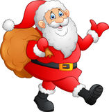 Santa ondulant et tenant le sac Photos stock