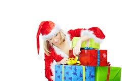 Santa opening Xmas gifts Royalty Free Stock Image
