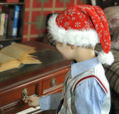 Santa opens a drawer table Stock Photo