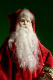 Santa Ornament. Antique Santa ornament on a dark background Stock Photo