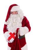 Santa pôs a caixa no saco Foto de Stock Royalty Free