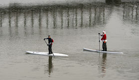 Santa on paddleing board Stock Photo