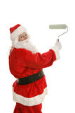 Santa Paints with Roller Royalty Free Stock Photography