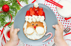 Santa pancake - Christmas breakfast idea for kids , adorable pan. Cake with strawberry and whipped cream Stock Photo