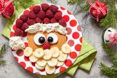 Santa pancake with raspberry for kid breakfast. Christmas Santa pancake with raspberry and banana for kid breakfast Stock Photos