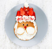Santa pancake with strawberry for kid breakfast. Picture on the Stock Images