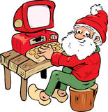 Santa with PC. Santa using a personal computer and sitting on a log Royalty Free Stock Photo
