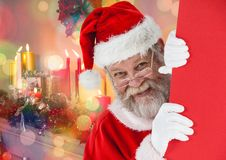 Santa peeking out from behind the wall Stock Photos