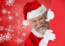 Santa peeking out from behind the wall Royalty Free Stock Image