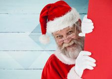 Santa peeking out from behind the wall Stock Photography