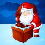 Santa peeping through fireplace chimney Royalty Free Stock Image