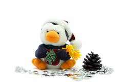 Santa Penguin with pine cone and silver stars. Stock Photography
