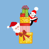 Santa and penguin with presents Royalty Free Stock Photo