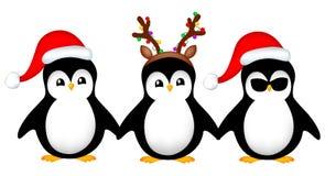 Santa penguins Royalty Free Stock Images