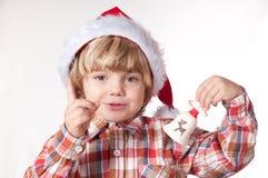 Santa, pensent bien ce qui sera mon cadeau Image libre de droits