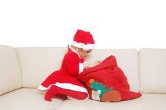 Santa pequena com o saco vermelho cheio dos presentes Imagem de Stock Royalty Free