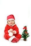 A Santa pequena com uma pele-árvore Imagens de Stock