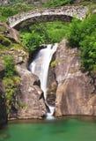 Santa Petronilla waterfalls with roman bridge in Biasca, Switzerland Royalty Free Stock Image